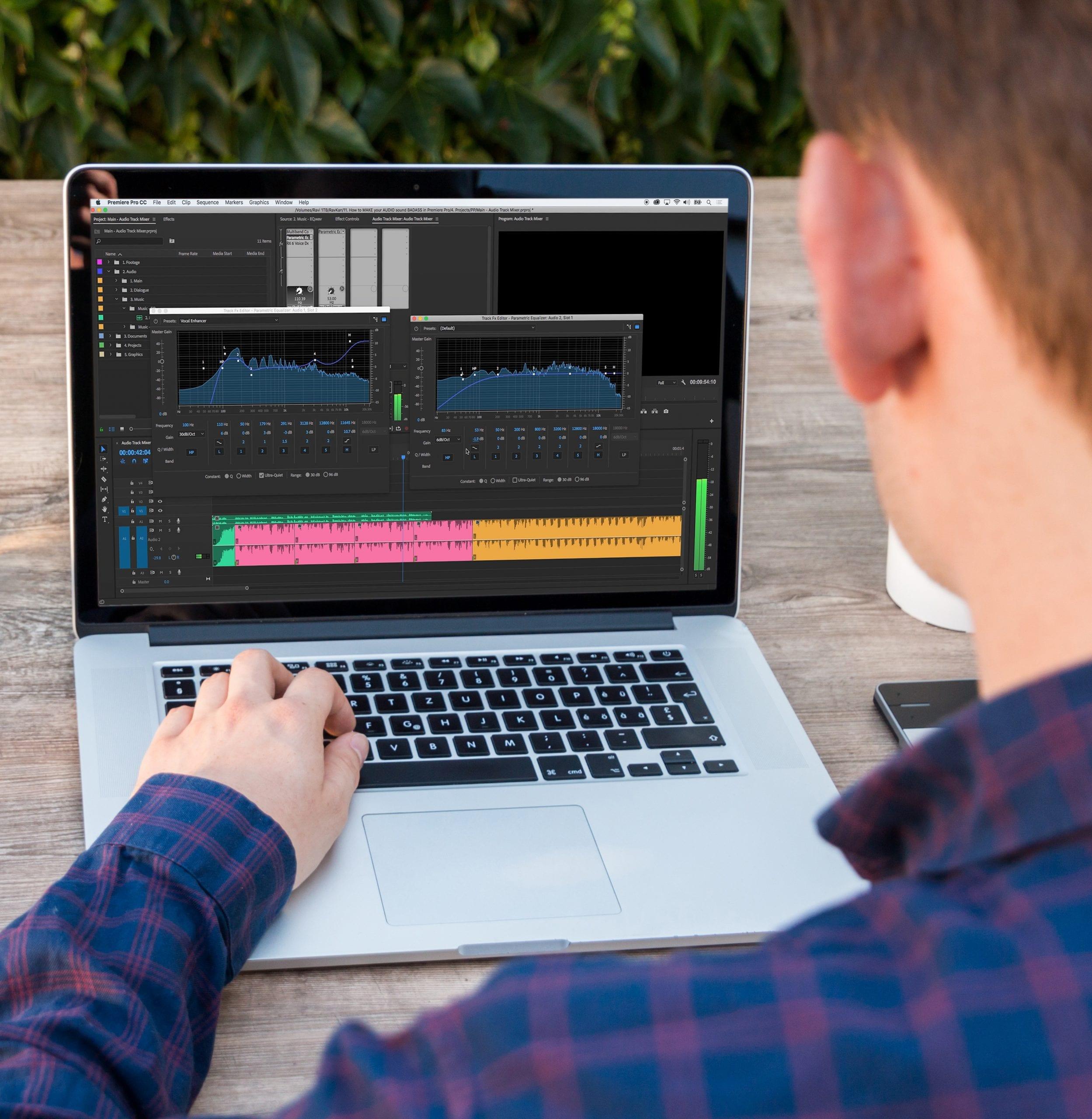 man-on-laptop-premiere-pro-audio