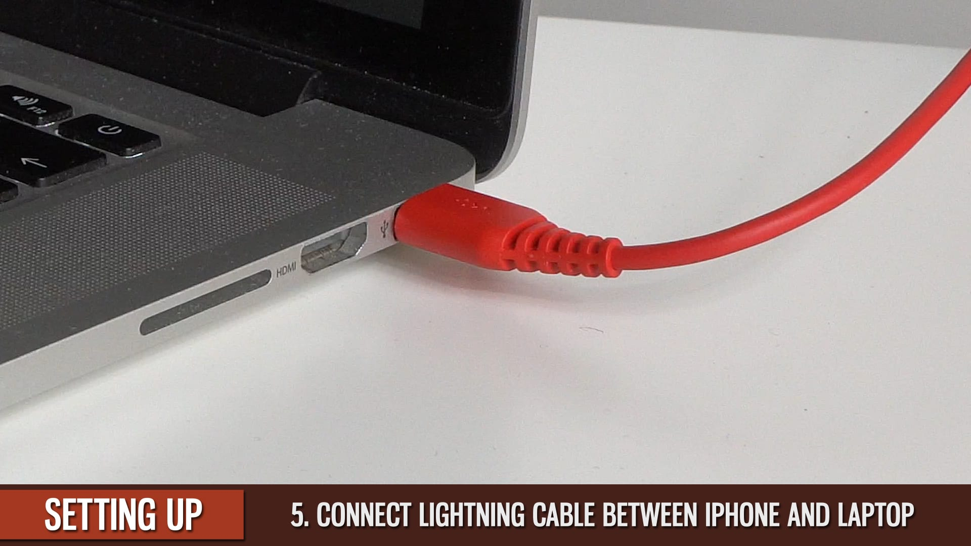 IPhone-Overhead-Connect Lightning-Cable-to-Laptop